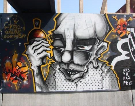 Under Pressure Festival zone 2014 - Okies on boarded wall