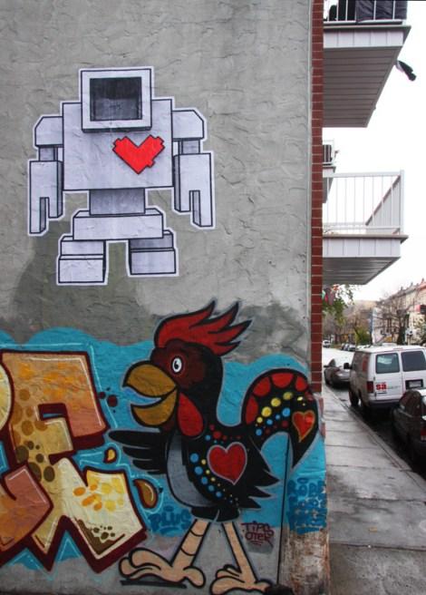 wheatpaste by Lovebot in alley off Villeneuve