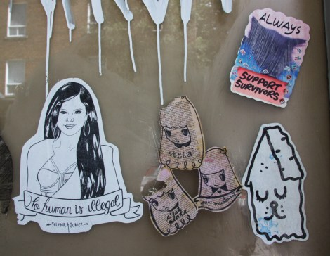 Paste-ups by Stela (centre), Selena Gomez (left), Homsik (right) and unidentified artist (top right)