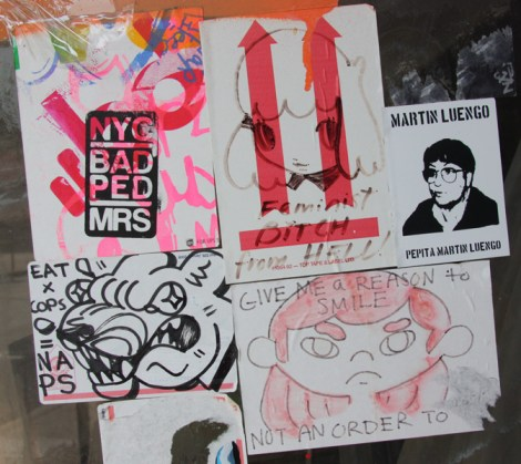 Stela sticker (top centre) surrounded by stickers from other socially minded artists and collectives (such as Wall Of Femmes top right)