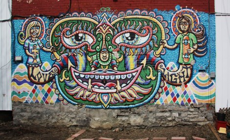 Chris Dyer on back of private residence, view from back alley.