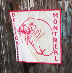 Decolonizing Street Art sticker in alley between St-Laurent and Clark