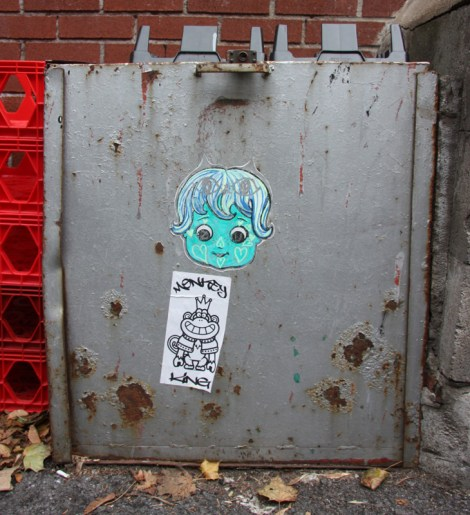 Zu paste-up (top) and Monkey King sticker (bottom) in alley between St-Laurent and Clark