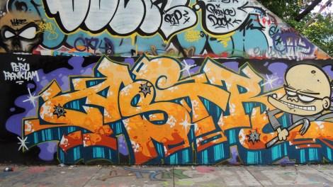 Astro at legal graffiti tunnel on de Rouen; photo © Astro