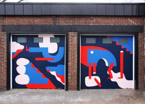 unidentified artist on garage doors at Plaza Walls