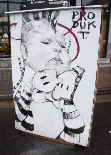 Alex Produkt on the back of an information panel for the 2015 edition of Mural Festival
