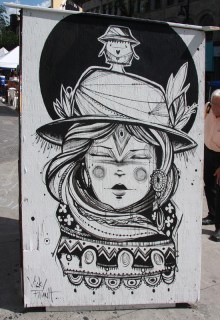 Vicky Filiault on the back of an information panel for the 2015 edition of Mural Festival