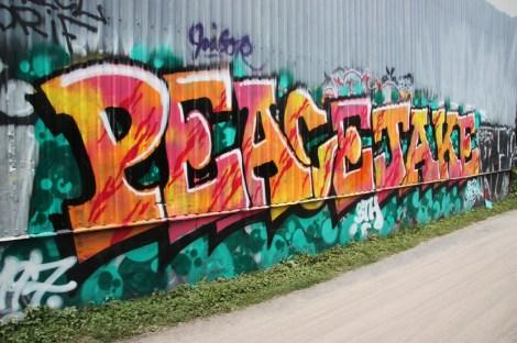 PeaceJake next to bike path in Petite Patrie