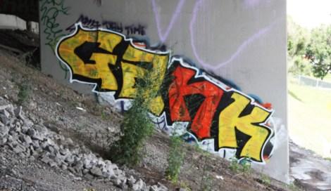 Gang piece underneath expressway