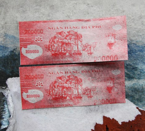 mock-currency paste-ups by unidentified person