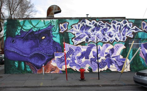 left half of a POM crew wall in Hochelaga, featuring Elfu (dinosaur), Serum (top right) and Aces (bottom right)