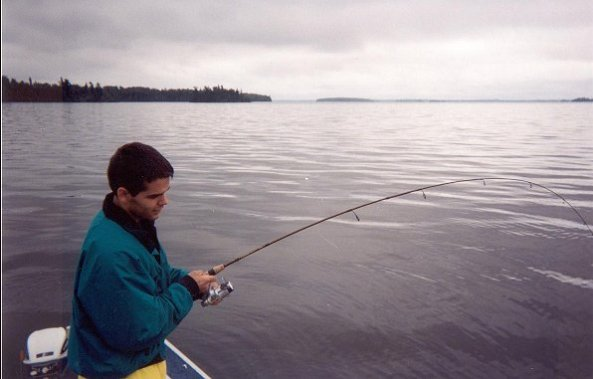 Reeling in a walleye on Lac Seul.
