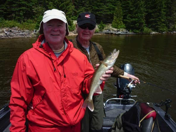 Denny and Dave with a typical Canada walleye and beautiful backdrop.