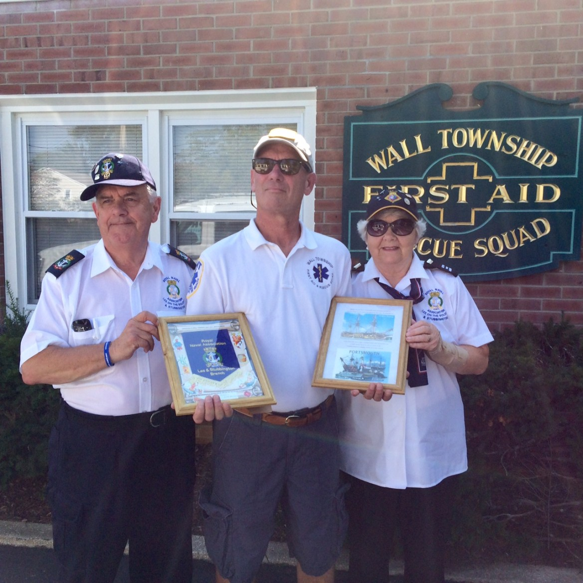 Paul and Ann Watson making the presentation to Squad Captain Joe Messer.