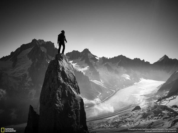 Black Man Climbing Mountain