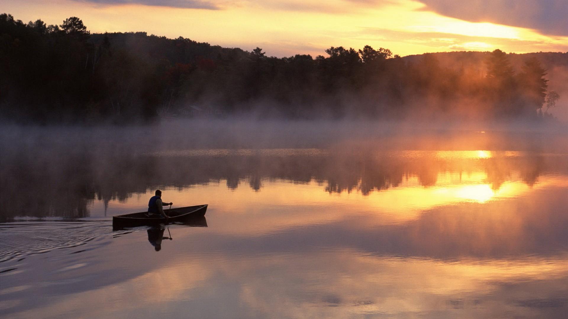 Row Boat on Lake at Sunset