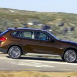 Bmw X1 Side Speed Brown Wallpapers Bmw X1 Side Speed Brown Stock Photos