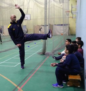 Mo Sheikh Teaches the Steps in a Bowling Action