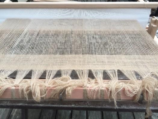 A rigid heddle loom warped with thin yarn