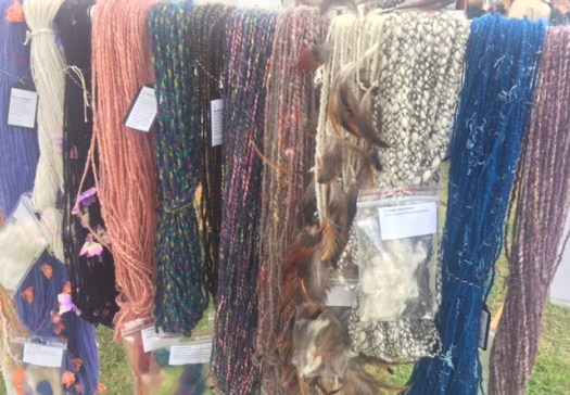 A row of art yarns of different colours and styles.
