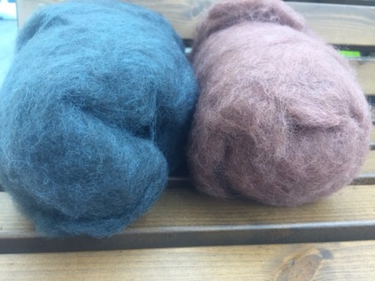 Two carded batts, a blue and a dusty rose