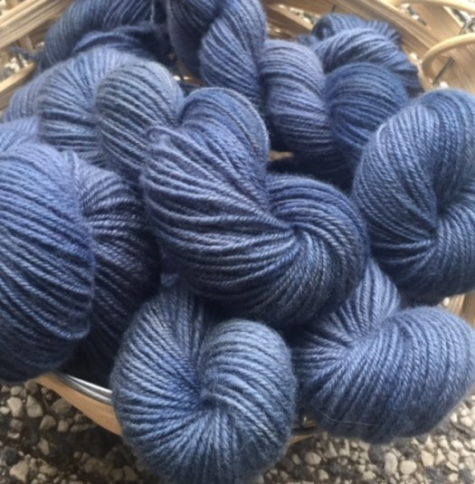 A basket of skeins of blue handspun yarn