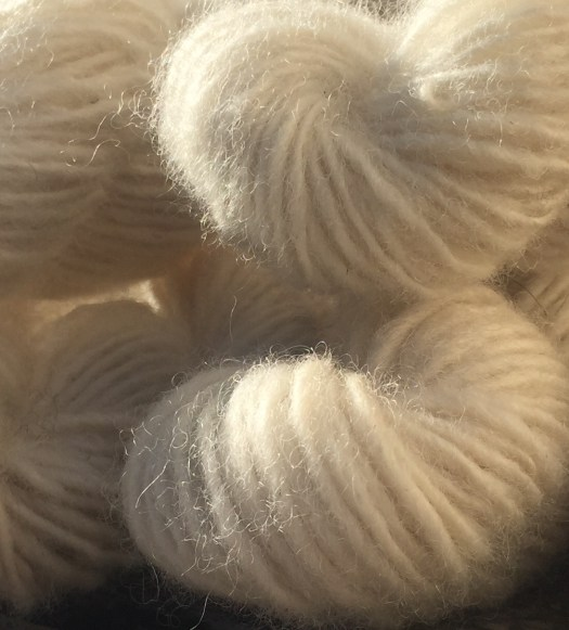 Closeup of skeins of yarn in backlight