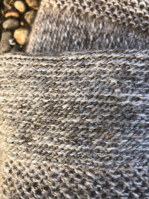 Close-up of a grey mitten turned inside-out.