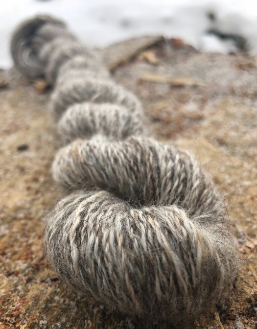 A skein of yarn in shades of grey.