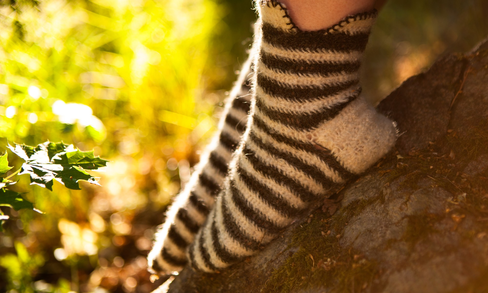 A pair of striped socks in backlight