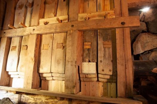Wooden stocks in a fulling mill.
