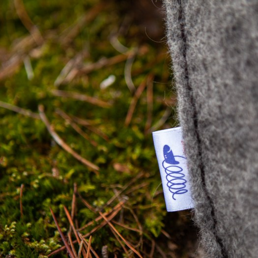 Close-up of a woolen tube with a woven logo label.