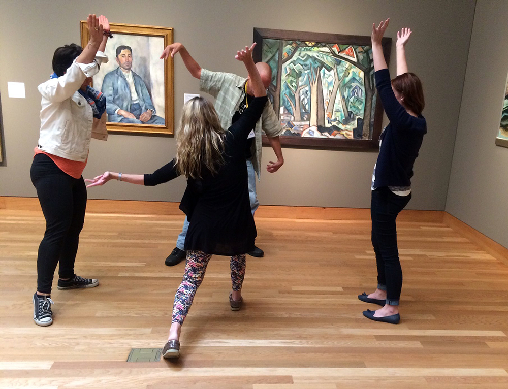 WAM Teacher Institute participants explore the possibilities of the visual art through movement in the galleries