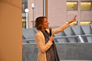 """Dr. Kathryn Cullen speaks into a microphone during the """"Pieces We Hold"""" workshop."""