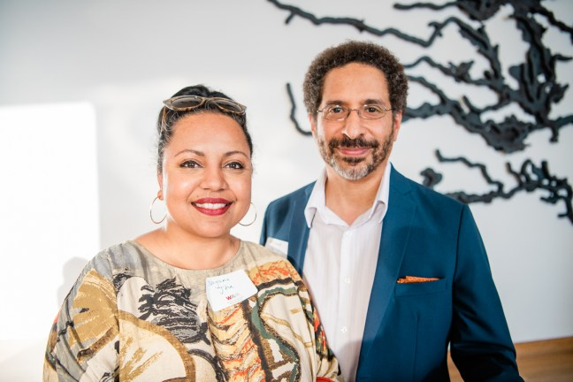 """Nayana and Michael at the opening for """"Rose and Melvin Smith: Remembering Rondo."""" They are smiling for the camera."""