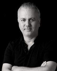 Black and white headshot of Luis Fitch