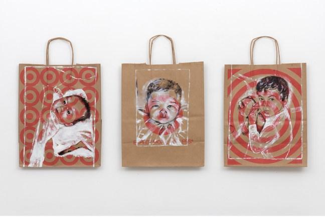 Three paintings of Korean children on Target store paper grocery bags