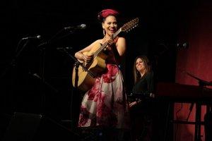 Azul Barrientos playing guitar