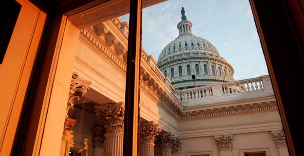 A view of the U.S. Capitol dome from inside the building as the sun sets.