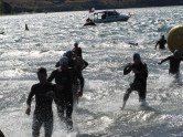 Pic two is of the same group of men exiting the water after the 750m swim in rough conditions. Jeno is second on the left, in blue cap and goggles. Marjorie