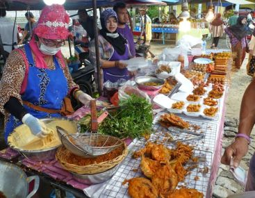 Frying things at Kamala market, Phuket.