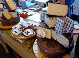 Borough Market cheeses, London.