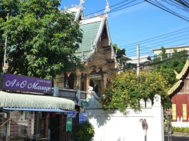 Massage and temple life side by side in Chiangmai.