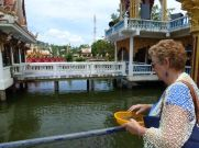 Barb feeding the fish at the Wat Ban Plai Leam temple at Bo Phut in Koh Sumai.