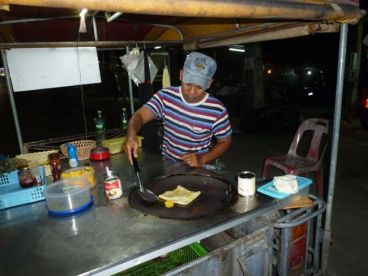 Making pancakes on the main road in Kamala.