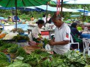 Prepping greens at the Nai Yang market.