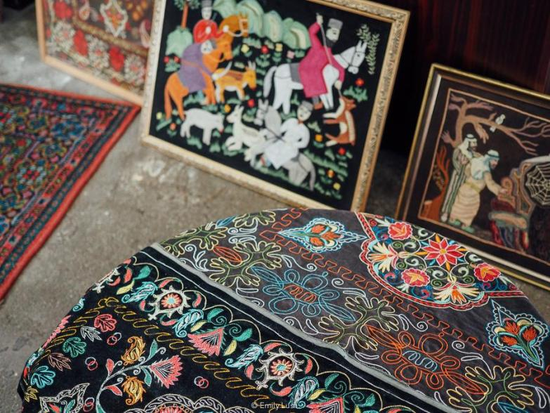 A display of textiles and paintings at a museum in Sheki Azerbaijan.