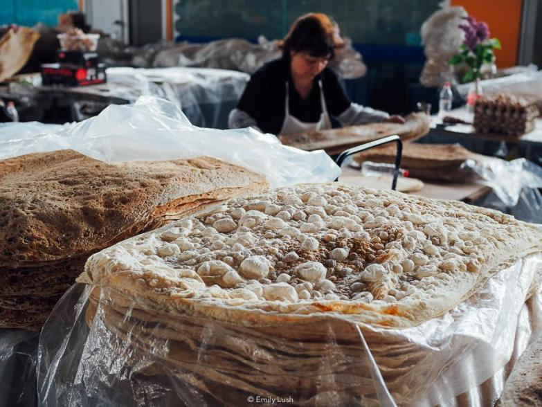 Stacks of bubbly lavash bread at the GUM Market Yerevan.