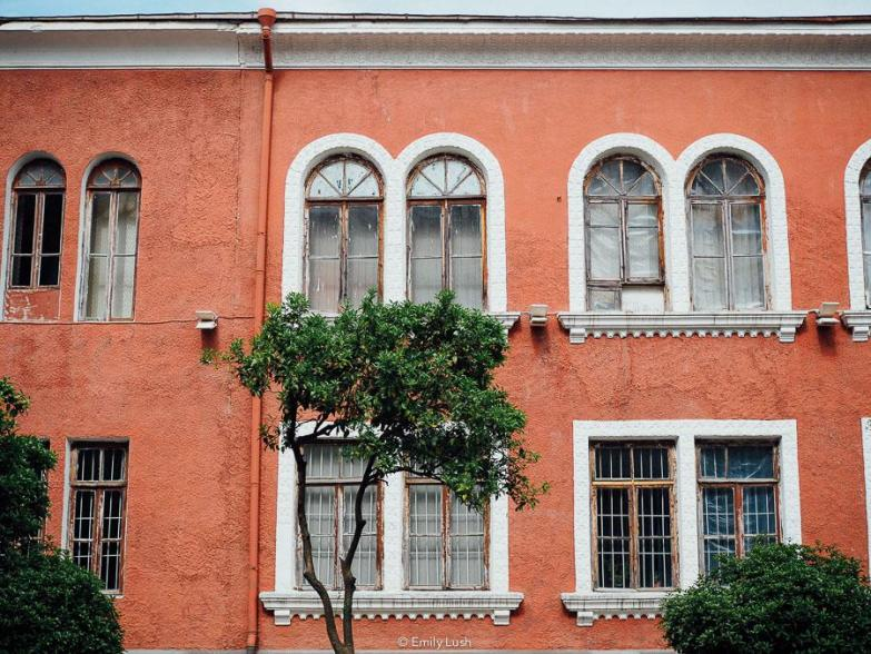An orange facade with white windows.