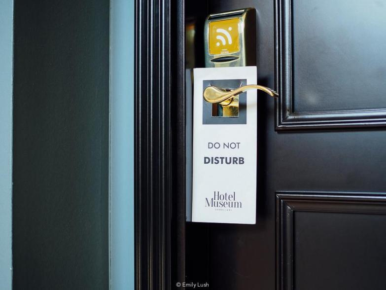 A sign hanging on a hotel room door reads 'Do not disturb: Museum Hotel Orbeliani'.